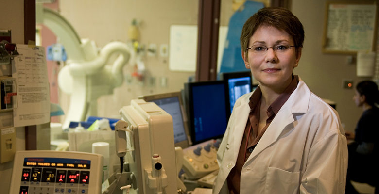 CHÉOS Program Head of Cardiovascular Health Dr. Karin Humphries in medical lab, medical device clinical studies