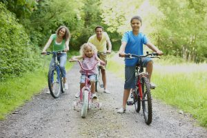 young family enjoying a bike ride in the country